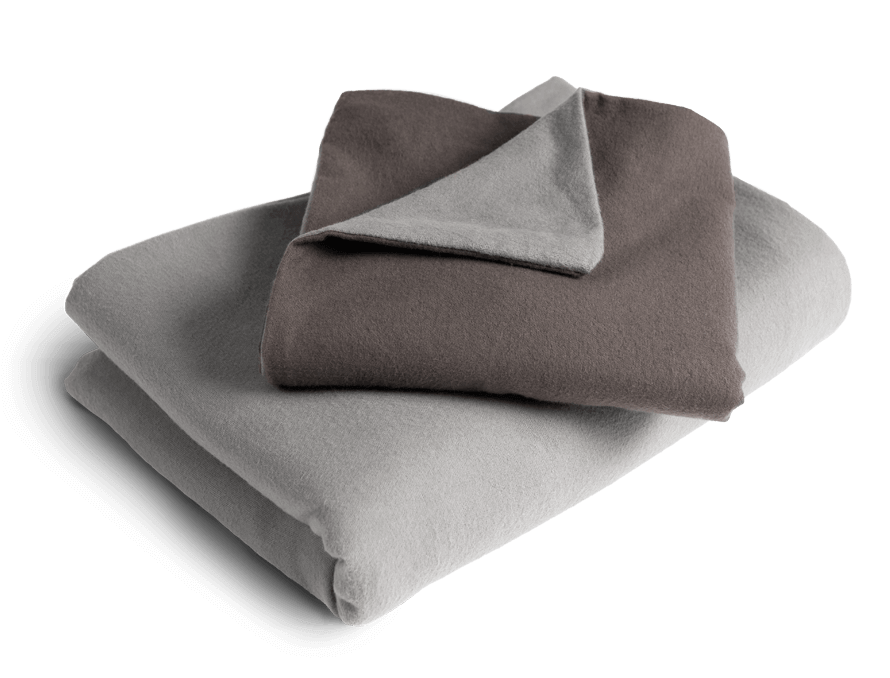 Photo: The folded cover of the Flannel Bed Linen for the duvet with the silver side facing out. On top of it the pillow case with the anthracite side up and a folded corner showing the silver side.