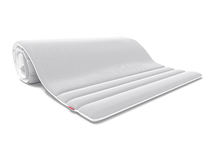 The half-rolled BODYGUARD Topper with the ergonomic modules matching the BODYGUARD Mattress.