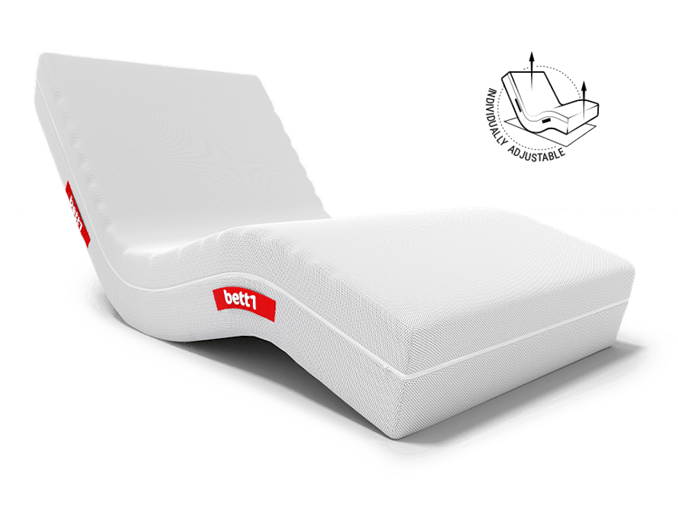 The Hulk mattress with adjustable head and foot section as lounge furniture. Next to it stands: individually adjustable