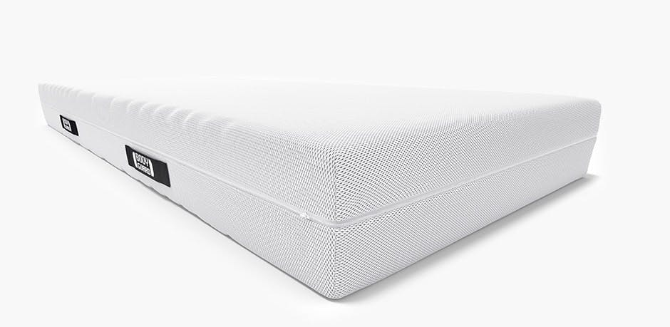 Illustration: The BODYGUARD Anti-Cartel-Mattress. The cover is folded up on one side to reveal the varicoloured mattress core. On the top is the light, firm side (H4).