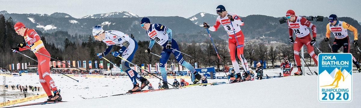 Foto: Sechs Skilangläufer im Rennen; auf ihrem Trikot Werbung für bett1.