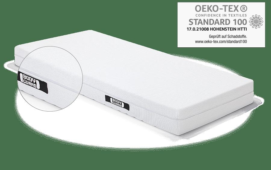 Die BODYGUARD Matratze. Darüber das OEKO-TEX Standard 100 Prüfsiegel.